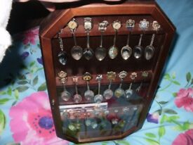 Spoon collection in mahogany glass cabinet