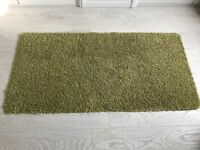 Small green rug (x2)