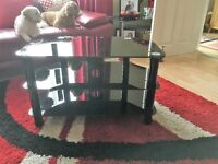 Black glass TV stand, 3 shelves with a cable tidy at the back