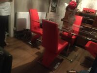 Strong tempered glass dinning table and 4 chairs cost £600 sell for £100