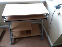 Computer desk top with pull-out tray