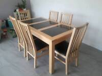 6 seater dining table (solid wood with granite inserts)