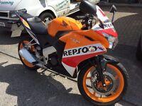 Honda cbr 125r Learner Motorbike in a stricking Repsol Orange