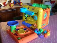 Brilliant Colourful Toddler Activity Cube Toy with Shapes, Numbers, Ball Run, Clock and More