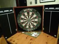 Dart board and cabinet