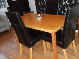 Solid Wood Dining Table and 4 Faux Leather Chairs.
