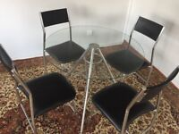 modern glass table and four chairs