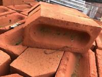 Red bricks edging corner shaped