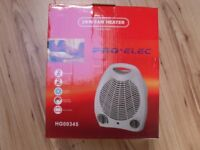 New boxed electric fan heater. 2KW 2 Heat settings, cool blow, Adjustable thermostat carry handle
