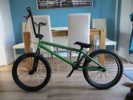 Custom Wethepeople BMX in candy apple green.