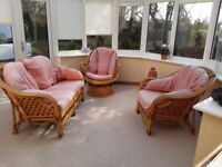Cane conservatory suite and dining table and 6 chairs