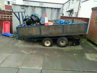 10 foot by 5 foot twin axle trailer .