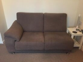 L-shaped brown fabric sofa