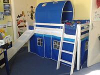 Boys loft style bed with slide. One year old in great condition