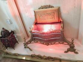 Electric Gold antique fire place and coloured glass stones which lights up bargain