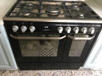 Black and silver John Lewis range cooker- two ovens, five hobs. RRP £900