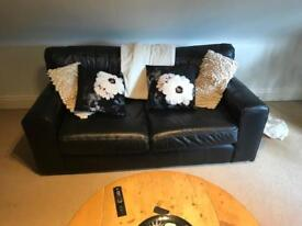 Black leather sofa (+ free pillows). Collection only.