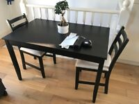 Stylish black table (118 X 74 cm) with 2 chairs - £55 only (Bought £140)