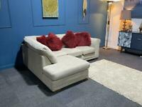 Next Corner sofa. The suite is a light cream