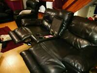 2 seater leather rock & Recline sofa
