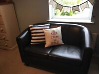 Small two seater faux leather sofa and arm chair. Dark brown with dark wooden legs