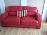 Red leather 3+2 seater sofas