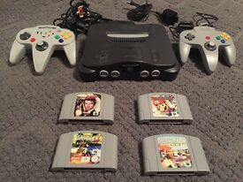 Nintendo 64 console with 4 games
