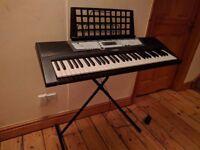 Yamaha PSR-E213 portable keyboard and stand.