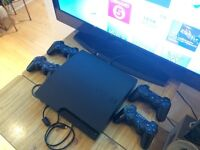 320GB PS3 Slim with four PlayStation controllers - like new