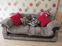three seater settie and a big round arm chair with corded mataria,also solid wood coffee table/tvl