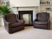 Pair of Vintage Brown Leather Chairs. Good condition for age, featuring original chrom castors.