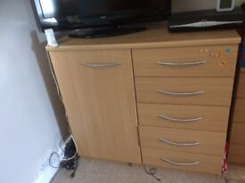 one double cupboard with drawers and one small chester drawers