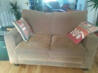 Beautiful two-seater sofa in good condition for sale