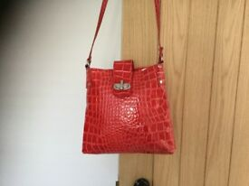 Leather handbag, red bought in Italy. Long shoulder strap.