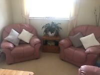 Pale pink leather sofa and armchair