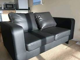 Month old black leather sofas