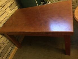 Sturdy and clean coffee table. Used but no damage, no scratch. Looks new