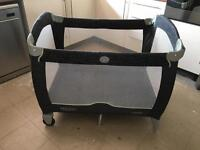 Graco travel cot with thick mattress.