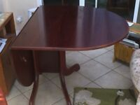 Solid mahogany drop leaf dining table - excellent condition