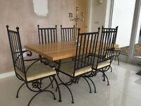 In need of refurbishment, wrought iron/white oak table with 6 chairs and matching stool.