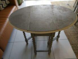 Vintage Solid Drop Leaf Oval Table For Sale