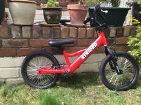 Strider red balance bike,older kids 6-8, as new.