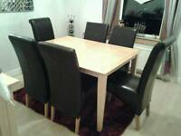 ,large extending dining table and six chairs