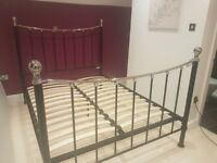 Black metal kingsize bedframe in spare room hence excellent condition