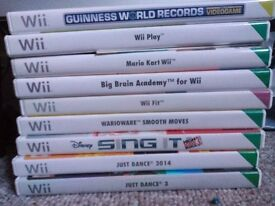 Wii console, Wii fit balance board, controls and games bundle