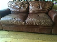 2 seater leather sofa , has fire resistant tag, originally Annie Mo's, for quick sell and collection