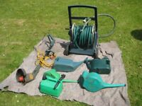 Garden Hose With Trolley. Plus Strimmer And Watering Cans. Plus Petrol Can.