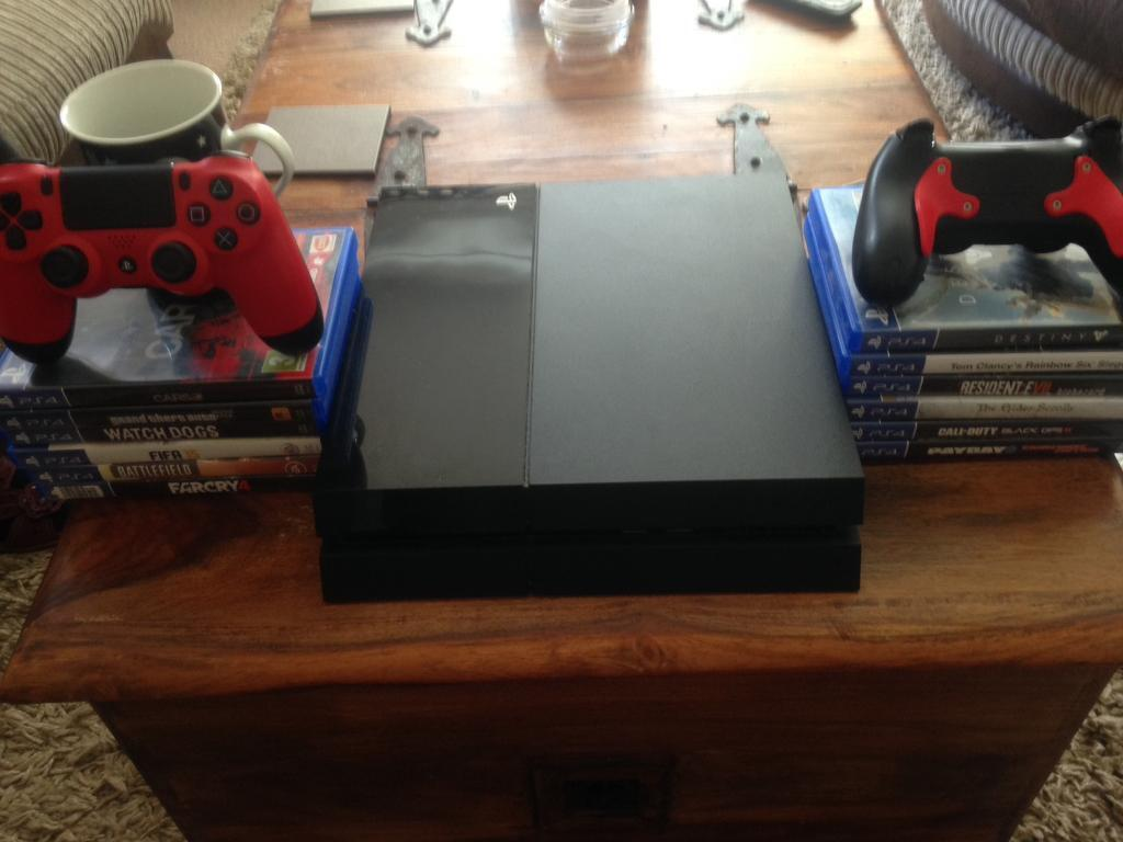 "PS4 1TB12 Games2 Controllersin Porthcawl, BridgendGumtree - 1TB PS4 with 12 games and two controllers PS4 is excellent condition Games in excellent condition Red control in good condition ( left analog has a rip in the rubber )Black modded control in great condition ( rapid fire and ""A"",""B"" paddles on the..."