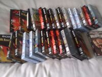 Over thirty Sony, FUJI and JVC VHS tapes and original films