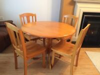 Oak circular table and four chairs